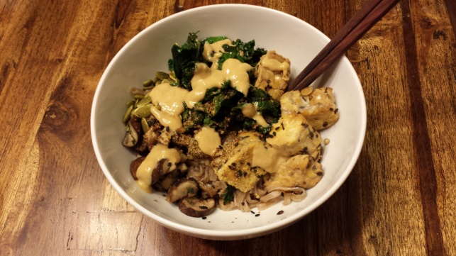 Tempeh with brown rice and seaweed noodles with a miso sauce.
