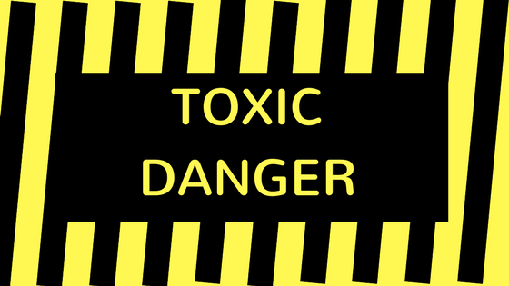 Yellow and black sign that says Toxic Danger